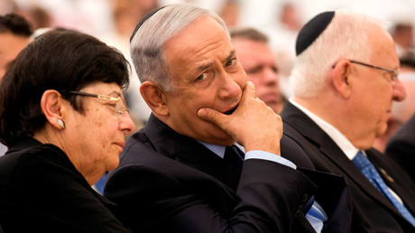 Israel's Prime Minister Benjamin Netanyahu (C), President Reuven Rivlin (R) and President of the Supreme Court Miriam Naor, attend a Memorial Day ceremony at Mount Herzl military cemetery in Jerusalem May 11, 2016. © Heidi Levine