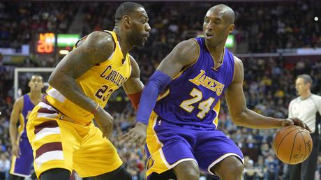 Cleveland Cavaliers forward LeBron James (23) and Los Angeles Lakers forward Kobe Bryant (24). © David Richard