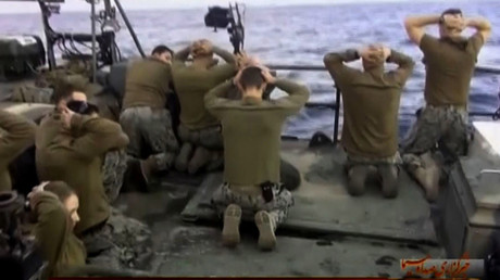 US sailors being apprehended by Iran's Revolutionary Guards after investigations showed their patrol boats had entered Iranian waters unintentionally © Iran's revolutionary guards website