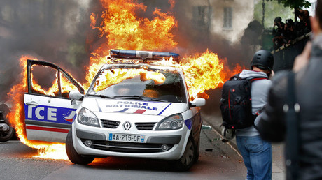 A police car burns during a demonstration against police violence and against French labour law reform in Paris, France, May 18, 2016. © Charles Platiau