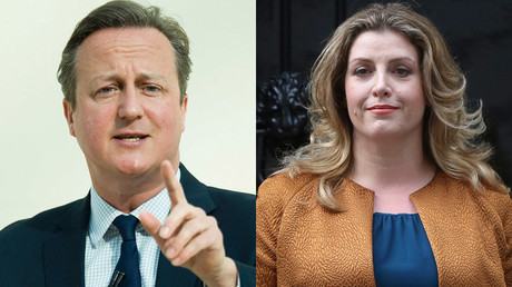 Britain's Prime Minister David Cameron and Penny Mordaunt © Reuters