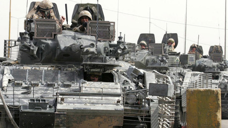File photo: British soldiers aboard tanks © Reuters