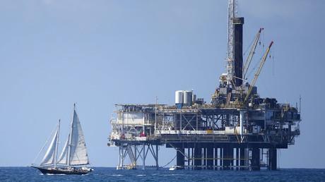 An offshore oil platform is seen in Huntington Beach, California © Lucy Nicholson