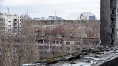 A containment shelter for the damaged fourth reactor (L) and the New Safe Confinement (NSC) structure (R) at the Chernobyl Nuclear Power Plant, Ukraine © Gleb Garanich