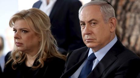 Israeli Prime Minister Benjamin Netanyahu sits with his wife Sara © Gali Tibbon