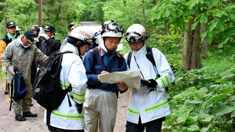 People search for a seven-year-old boy who went missing two days earlier, in Nanae town on the northernmost Japanese main island of Hokkaido, Japan, in this photo taken by May 30, 2016 © Kyodo