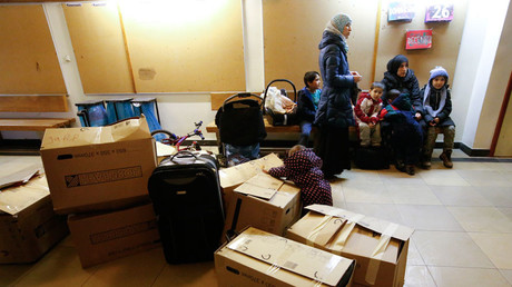 Migrants wait to get their rooms upon their arrival at a refugee shelter in Friedenau city hall in Berlin's Tempelhof-Schoeneberg district, Germany © Fabrizio Bensch