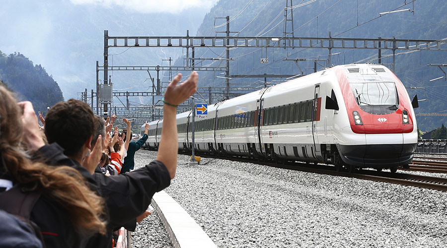 Guests waves at a train that has crossed the tunnel during the opening ceremony of the NEAT Gotthard Base Tunnel, the world's longest and deepest rail tunnel, near the town of Erstfeld, Switzerland June 1, 2016. © Arnd Wiegmann
