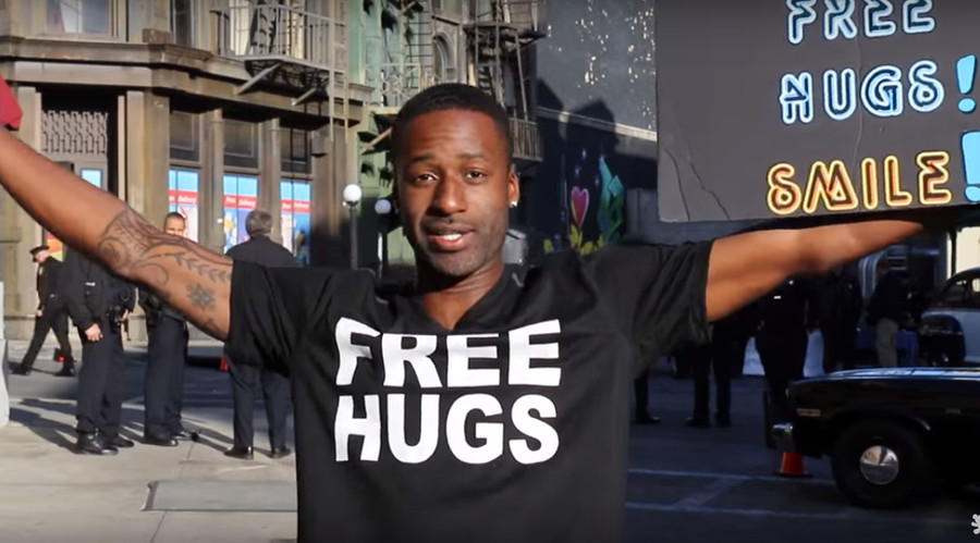 Man offers 'free hugs' at Trump rally, it goes as well as expected (VIDEO)