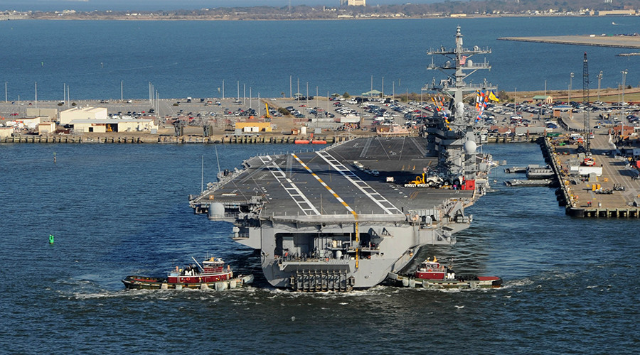 'Stepping up the fight': US Navy aircraft carrier heads to Middle East to battle ISIS