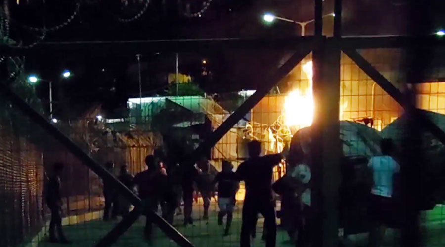 Inter-ethnic brawl between 150 refugees at Samos camp in Greece leads to blaze and arrests
