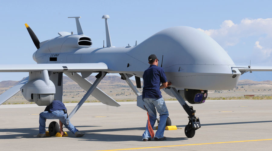 Workers prepare an MQ-1C Gray Eagle ©