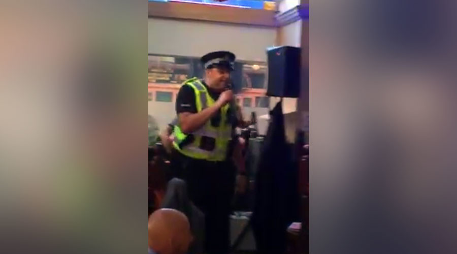 Karaoke cop: Policeman breaks up Glasgow bar fight & belts out disco classic (VIDEO)