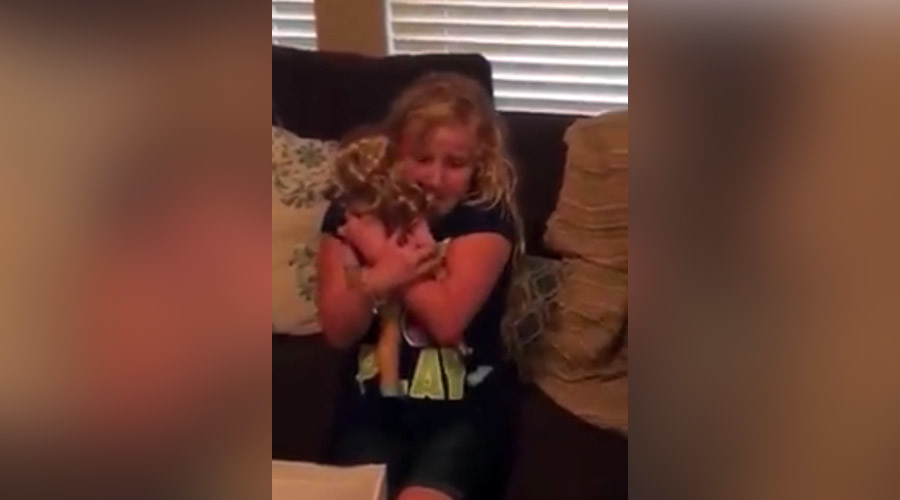 Young girl has tears of joy after receiving doll with prosthetic leg like hers (VIDEO)