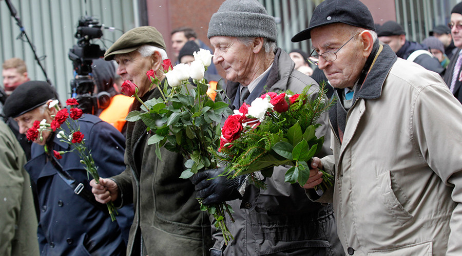 People take part in the annual procession commemorating the Latvian Waffen-SS (Schutzstaffel) unit, also known as the Legionnaires, in Riga © Ints Kalnins