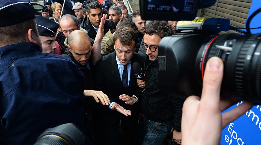 'Get lost!' French economy minister pelted with eggs amid labor reform strikes (VIDEO)