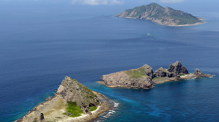 Japan protests Beijing's warships approaching disputed islands in E. China Sea