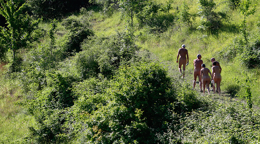 Naked & afraid: German nudist colony protests refugee shelter over safety concerns