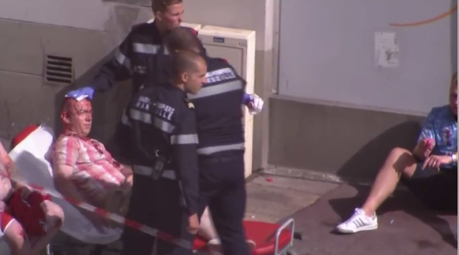 An injured football fan is being treated by medics in Marseilles © AP screenshot