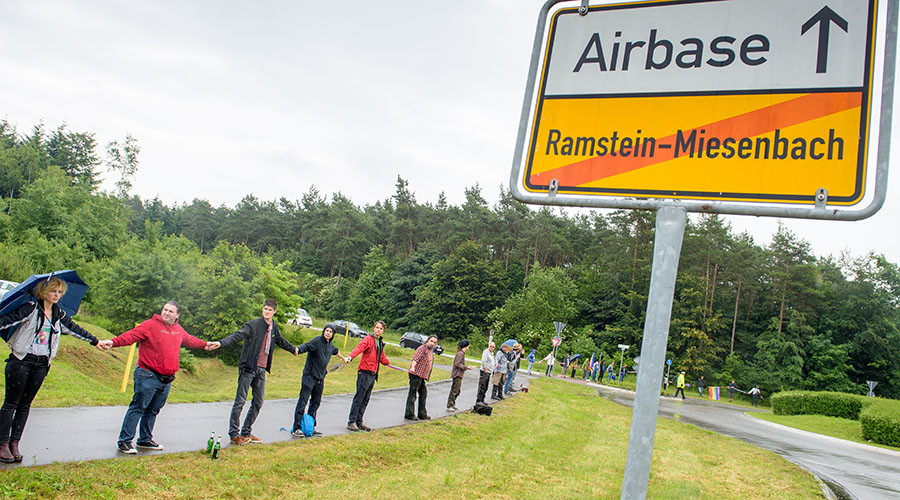 "Activists attend a rally ""Stop-Ramstein"" on the road leading to US Air Force Base in Ramstein-Miesenbach on June 11, 2016. © Oliver Dietze / DPA"