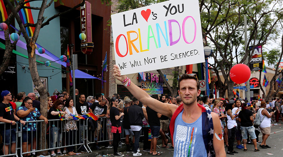 'World is a worse place today': Bittersweet LA Pride celebrations go on despite Orlando tragedy