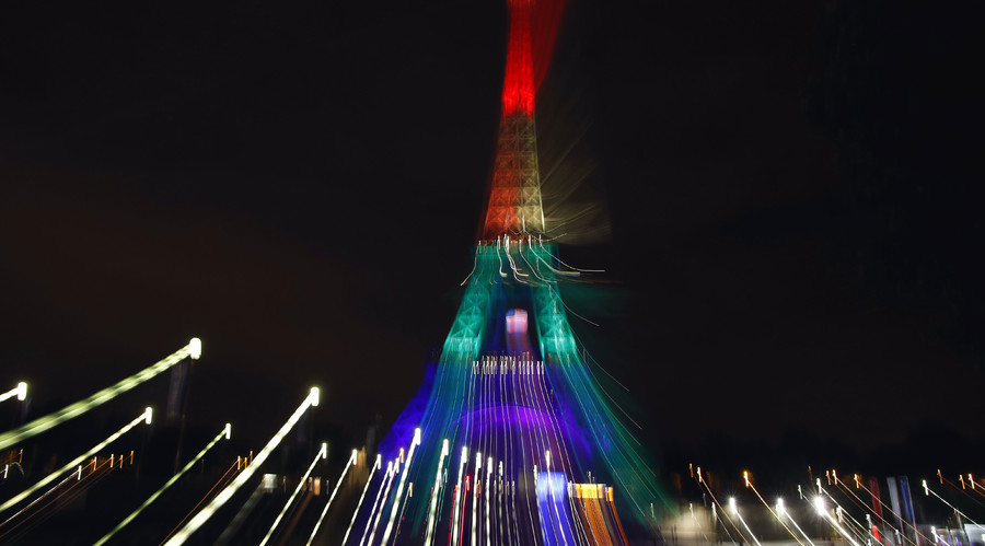 The Eiffel Tower is illuminated in memory of the victims of the gay nightclub mass shooting in Orlando, in Paris, France, June 13, 2016. © Gonzalo Fuentes