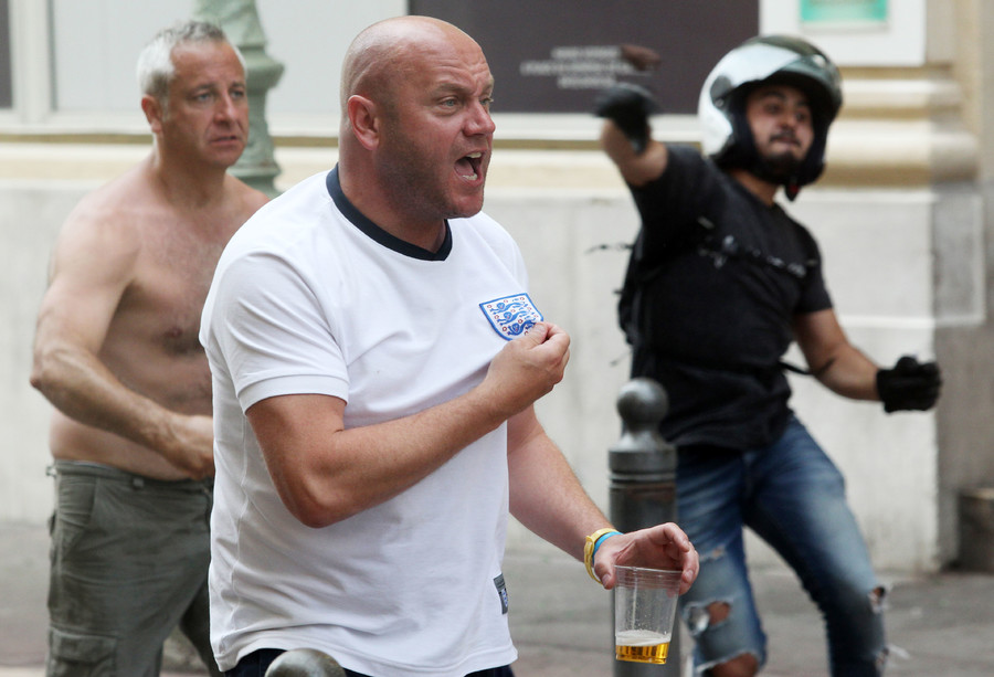 A supporter shows his shirt during street brawls ahead of the Euro 2016 football match England vs Russia, southern France, on June 11, 2016.