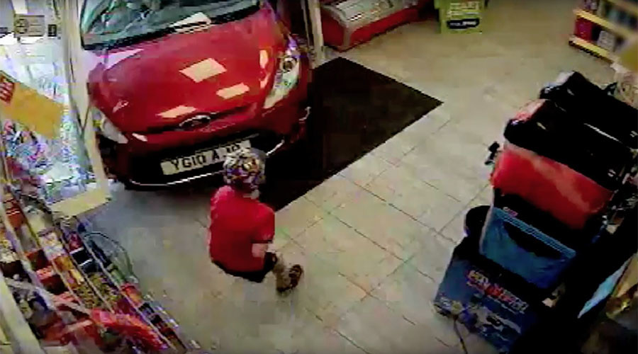 Reckless driver crashes through shop window, knocks down child (VIDEO)