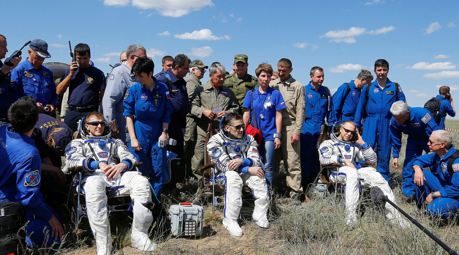 The International Space Station (ISS) crew members Timothy Peake of Britain, Yuri Malenchenko of Russia and Timothy Kopra of the U.S., surrounded by ground personnel, rest shortly after landing near the town of Dzhezkazgan (Zhezkazgan), Kazakhstan, June 18, 2016. © Shamil Zhumatov
