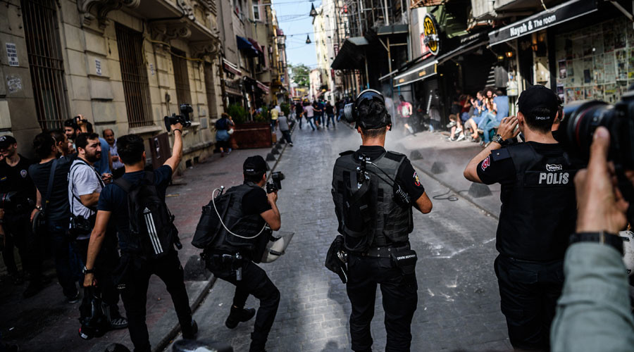 Turkish anti-riot police officers fire rubber bullets to disperse demonstrators gathered for a rally staged by the LGBT community on Istiklal avenue in Istanbul on June 19, 2016. © Ozan Kose