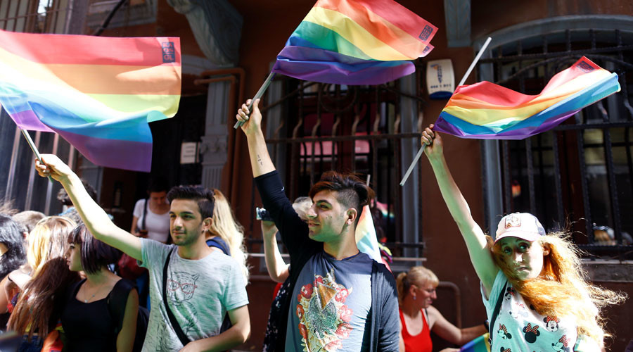 LGBT rights activists wave rainbow flags during a transgender pride parade which was banned by the governorship, in central Istanbul, Turkey, June 19, 2016. © Osman Orsal