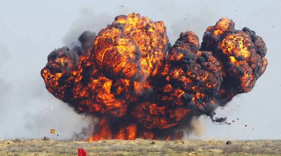 "FILE PHOTO: Explosive charge detonates during military exercises ""Center-2011"" on the Ashuluk range in the Astrakhan region. © Alexey Kudenko"