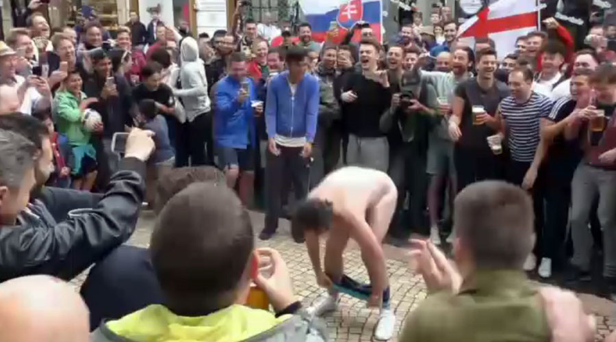 Fans in the flesh: England supporters strip down to cheer on football team (VIDEO)