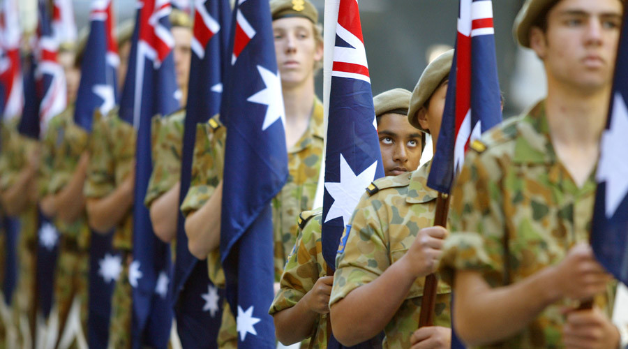 Flag bearing army cadets during a Battle For Australia commemoration in central Sydney September 3, 2003. © Will Burgess