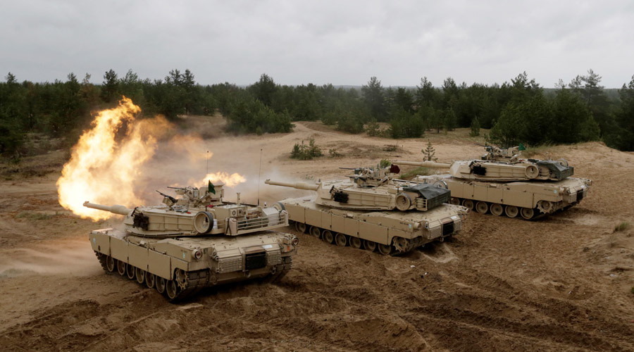 "U.S. M1 Abrams tanks fire during the ""Saber Strike"" NATO military exercise in Adazi, Latvia, June 11, 2016. © Ints Kalnins"