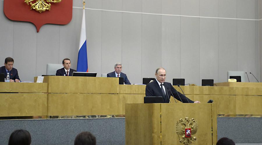 June 22, 2016. President Vladimir Putin, front, speaks at a State Duma plenary meeting. Back, from left: First Deputy Speaker Alexander Zhukov, Speaker Sergei Naryshkin and Deputy Speaker Ivan Melnikov. ©  Aleksey Nikolskyi