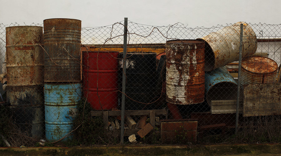 Rusted oil barrels, which are used as water tanks during the construction of buildings © Jon Nazca