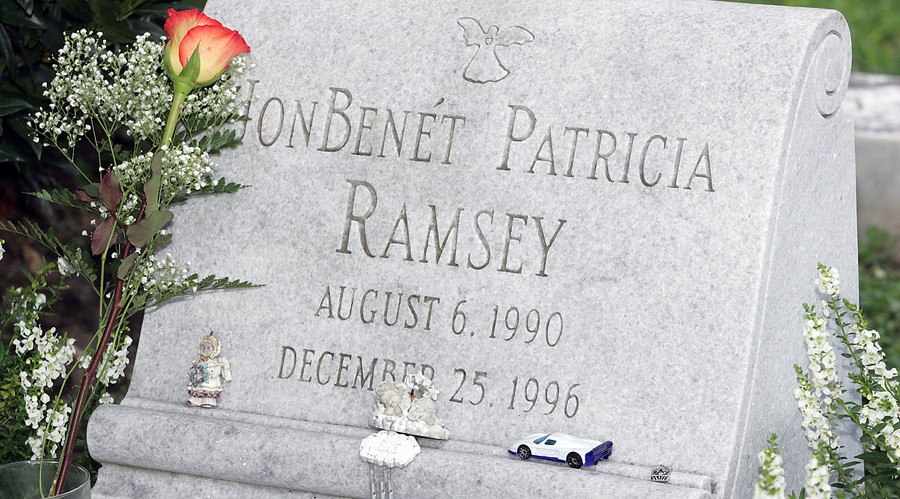 A lone rose lays at the gravesite of JonBenet Ramsey in Marietta, Georgia. © Tami Chappell