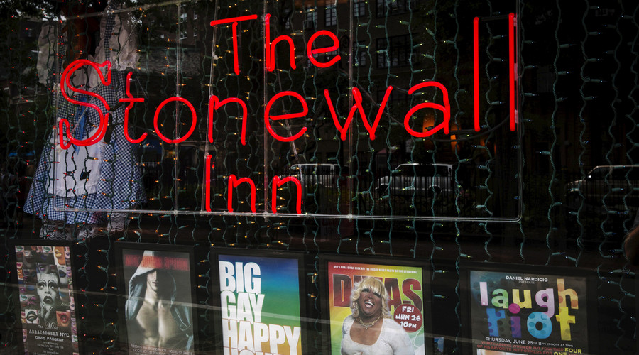 A neon sign shines in the window of the Stonewall Inn in New York, June 23, 2015. © Lucas Jackson