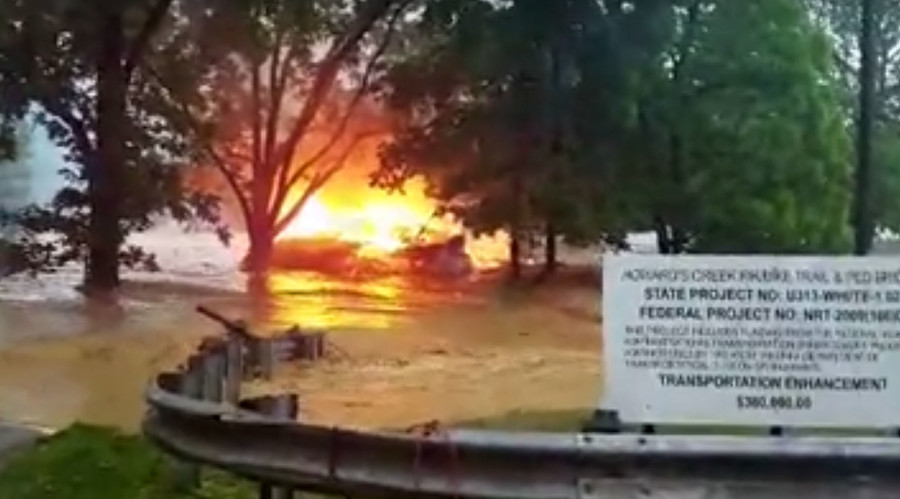 Burning house carried off by West Virginia flood (VIDEO)