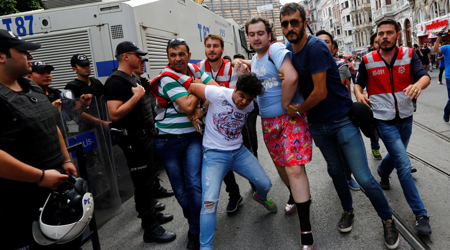 Plainclothes police officers detain LGBT rights activists as they try to gather for a pride parade, which was banned by the governorship, in Istanbul, Turkey, June 26, 2016. © Murad Sezer