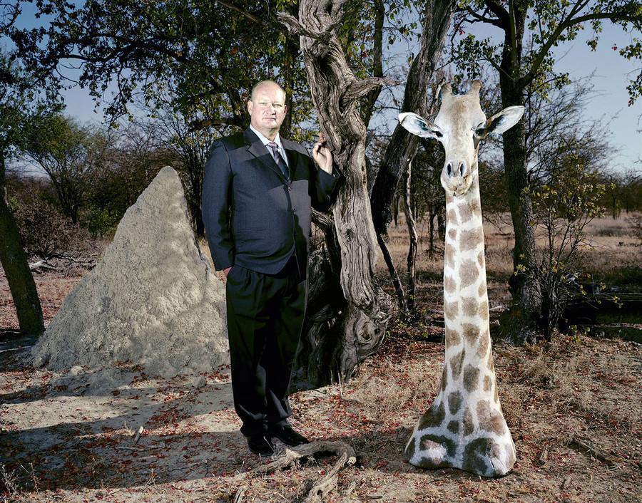 Gunter and a giraffe head in Otavi, Namibia.