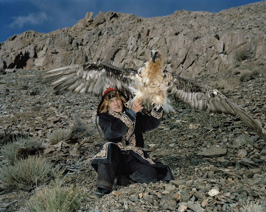 Takhan and a bearded vulture in Bulgan, Mongolia.
