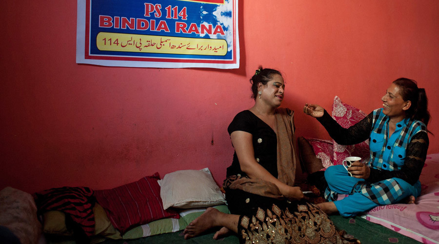Bindia Rana (R), a transgender independent candidate for the upcoming elections, chats with a friend at her home in Karachi May 7, 2013. © Insiya Syed
