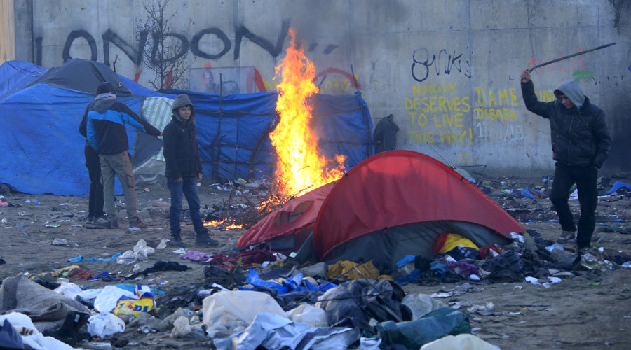 "A migrant hits a former shelter with a stick in a dismantled area of the camp known as the ""Jungle"", a squalid sprawling camp in Calais, northern France, January 17, 2016. © Pascal Rossignol"