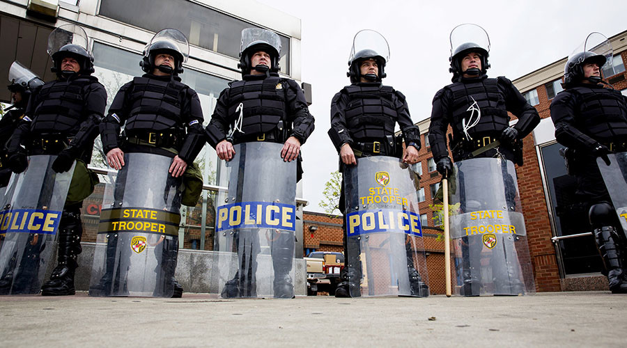 Heavy police presence as Baltimore residents grieve for slain rapper