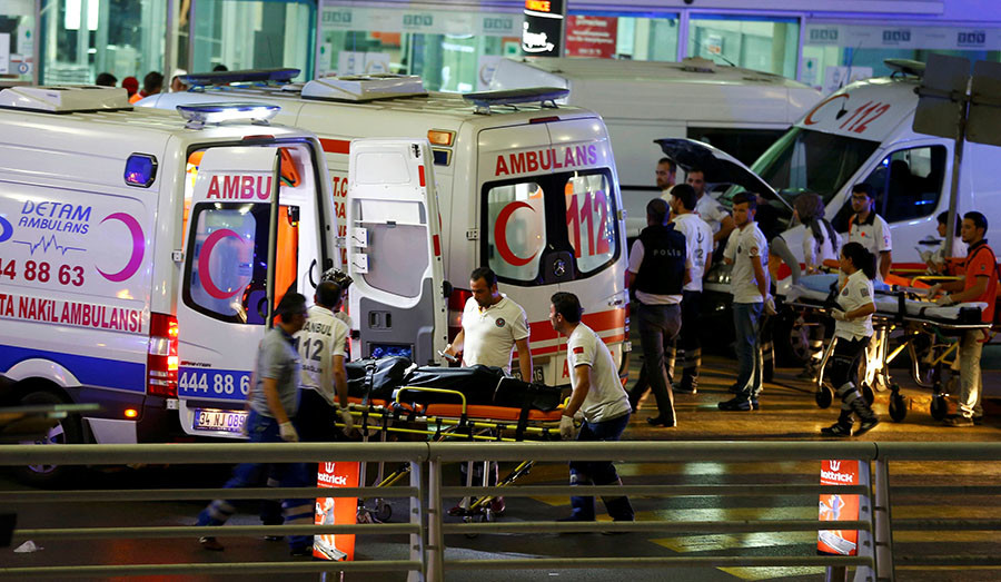Paramedics push a stretcher at Turkey's largest airport, Istanbul Ataturk, Turkey, following a blast June 28, 2016. © Osman Orsal