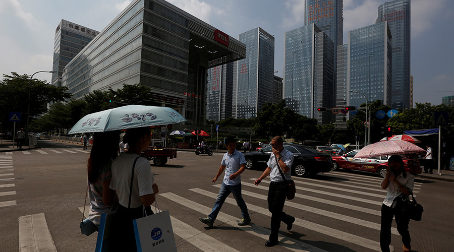 People cross a street at Nanshan district focusing on technology sectors in Shenzhen, China © Bobby Yip
