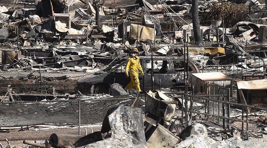 A firefighter walks among leveled homes after the Erskine Fire burned through South Lake, California, U.S. June 24, 2016. ©Noah Berger