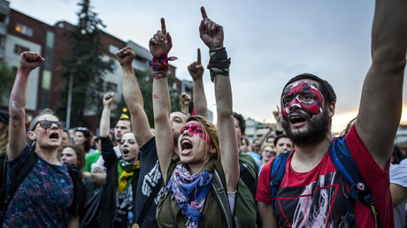 Protestors with painted faces shout slogans in front of the government building, during an anti-government protest in Skopje on June 6, 2016, in a series of protests dubbed Colourful Revolution. © Robert Atanasovsky